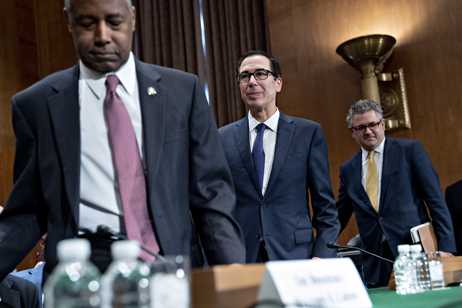 Ben Carson, secretary of Housing and Urban Development and, from left, Steven Mnuchin, U.S. Treasury secretary, and Mark Calabria, director of the Federal Housing Finance Agency, arrive at a Senate Banking Committee hearing in Washington, D.C., on Tuesday. (Bloomberg/Getty Images)