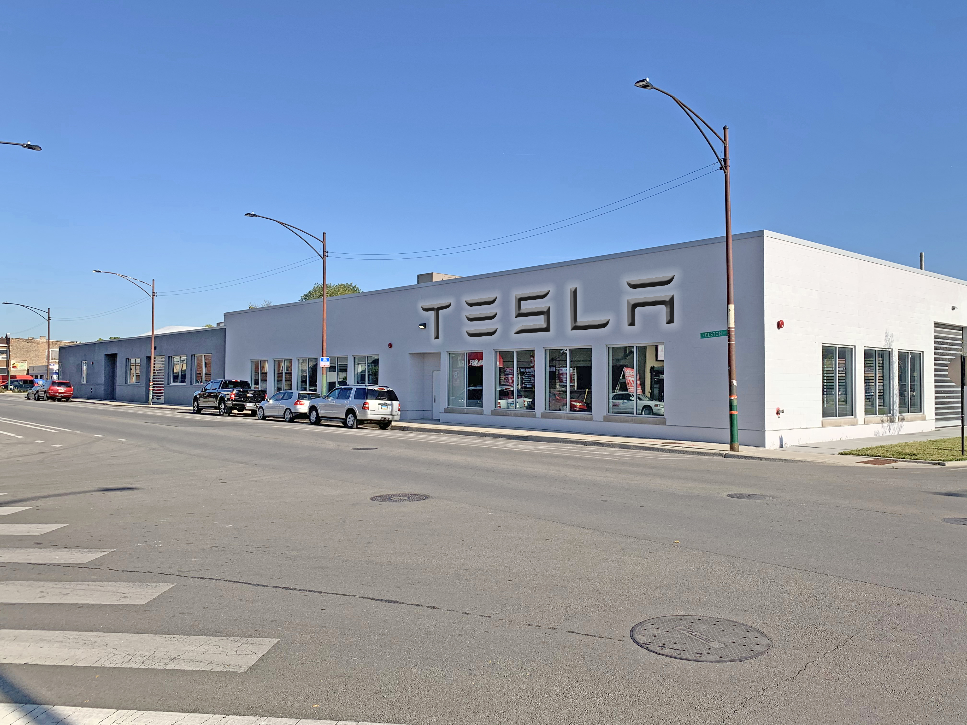 The Tesla service center at 3059-3067 N. Elston Ave. in Chicago sold for $13.1 million. (Cushman & Wakefield)