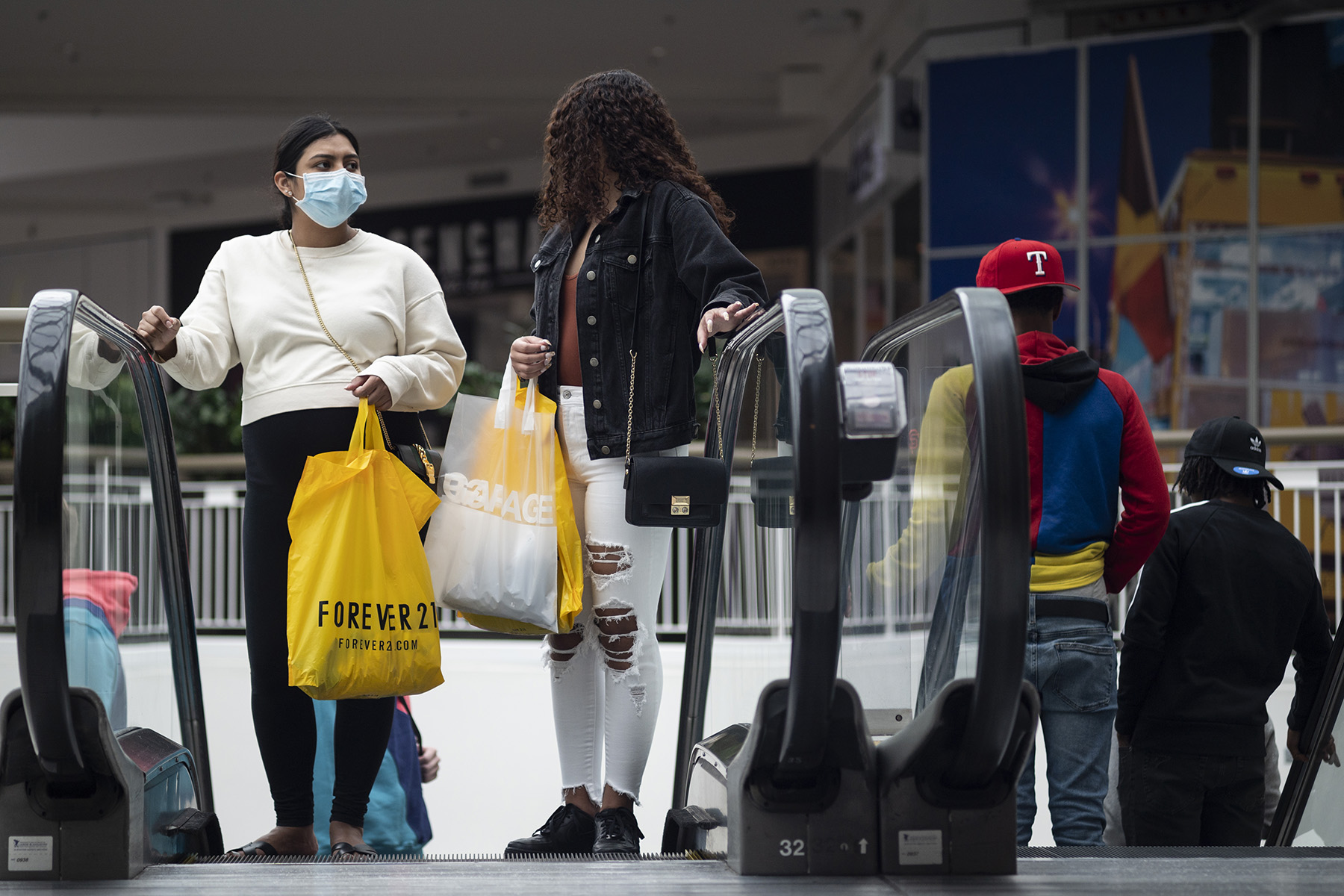 The National Retail Federation expects shoppers to return to shopping centers and malls in a big way for the rest of the year, driving up retail sales as much as 13.5%. (Getty Images)