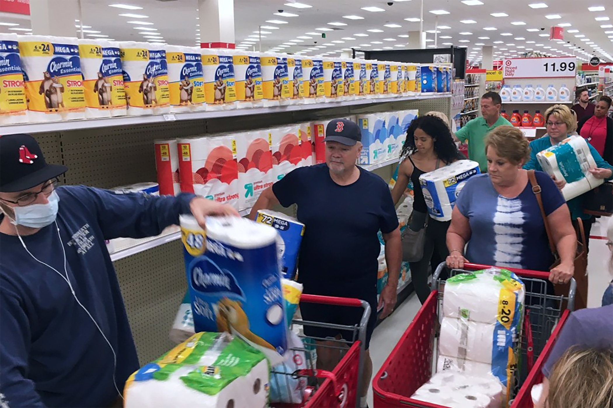 Customers rushed to purchase toilet paper at a Target store in response to the coronavirus pandemic. (Getty Images)