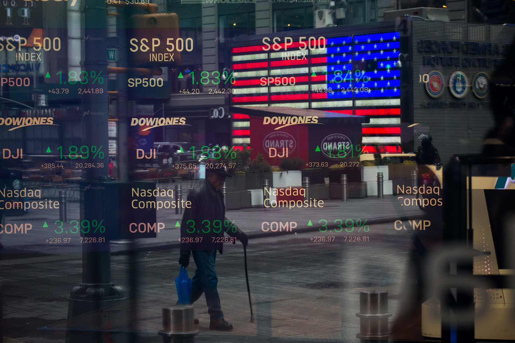 Monitors displaying stock market information are seen through the window of the Nasdaq MarketSite in the Times Square neighborhood of New York. (Getty Images)