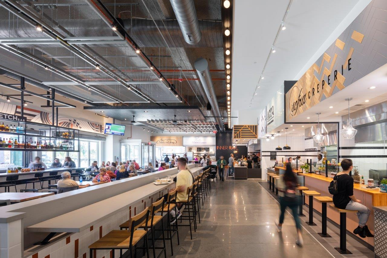 Food halls, such as the Inner Rail in Omaha, Nebraska, have large common areas that permit patrons to maintain safe distances but still get a sense of being in a social environment. (Eimer Design)
