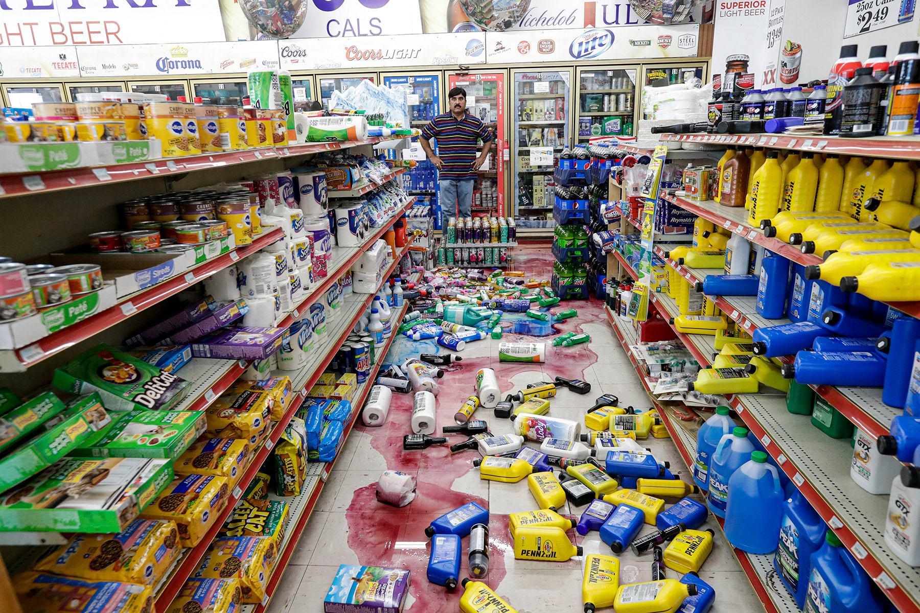 Javaid Waseem, owner of the Minit Gas Station and retail store in Ridgecrest, California, surveys damage from a July 5 earthquake, the second of two quakes. Photo: Irfan Khan/Los Angeles Times via Getty Images