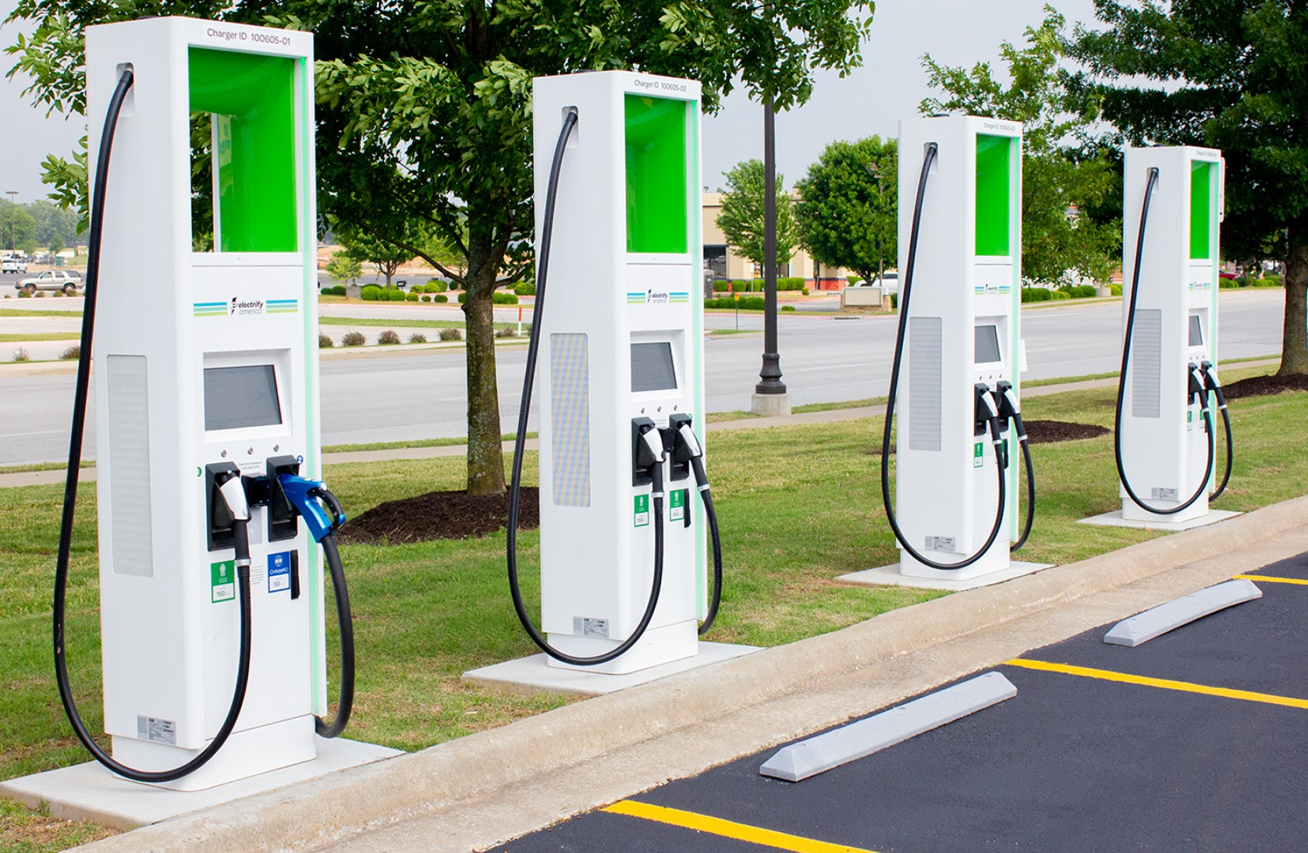 Electric-vehicle charging stations are showing up at suburban shopping centers and in parking lots at retailers such as Walmart. (Walmart)