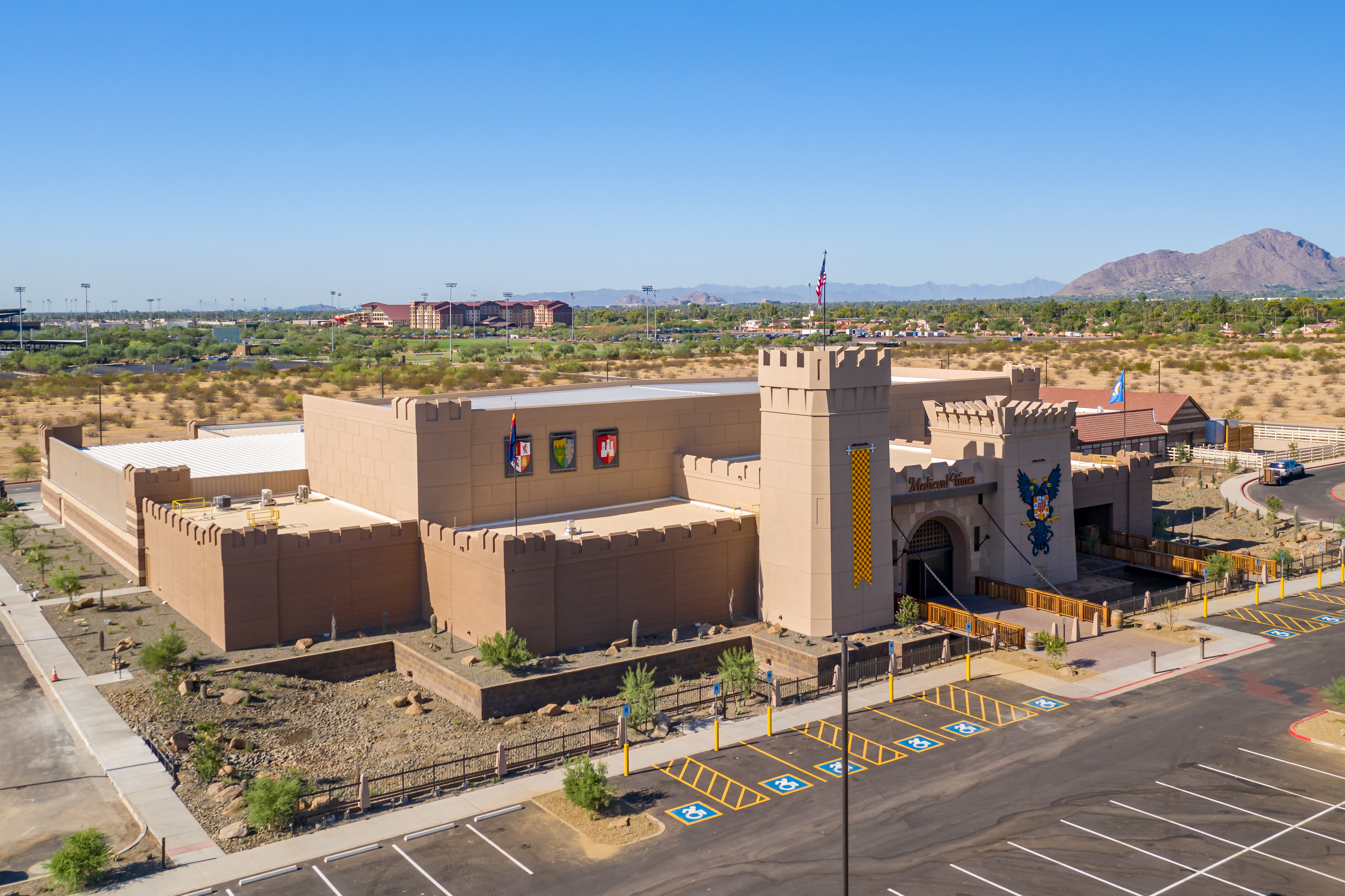 An 80,000-square-foot Medieval Times is the most recent addition to the Talking Stick Entertainment District in the Central Scottsdale submarket. In the distance is a view of the Great Wolf Lodge, hotel and indoor water park, which is nearing completion. (CoStar)